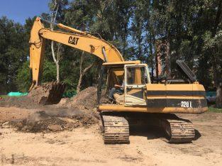 Retro excavadora sobre orugas Caterpiller 320L