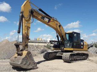 Excavadora Cat 3202L.
